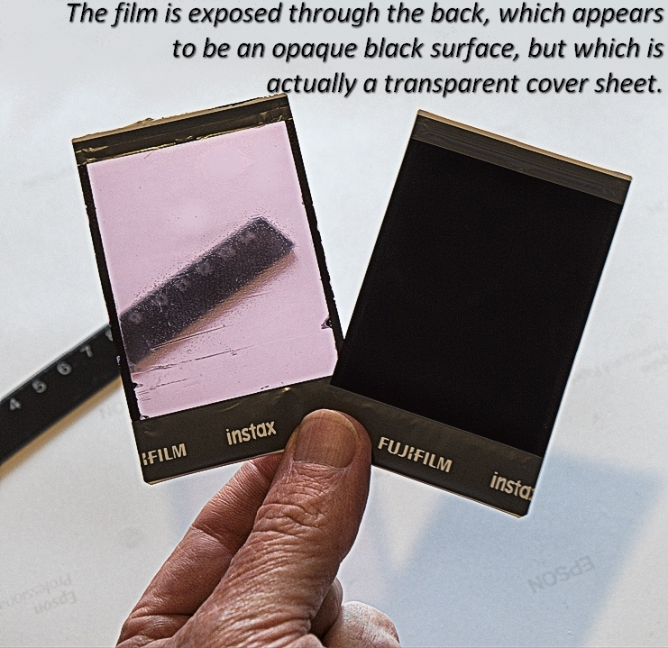 Exposure side of Instax Mini instant film showing transparent cover sheey